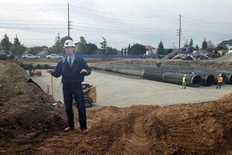 Penfield & Smith engineer Don Donaldson discusses the installation of the underground water treatment system at the Hollister Village.